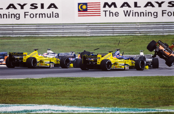 Gastón Mazzacane, Minardi M02 Fondmetal, and Marc Gené, Minardi M02 Fondmetal, take avoiding action afterPedro de la Rosa, Arrows A21 Supertec, is pitched in to the air due to a first lap collision with Nick Heidfeld, Prost AP03 Peugeot, and Pedro Diniz, Sauber C19 Petronas.