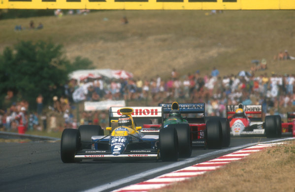 1990 Hungarian Grand Prix.Hungaroring, Budapest, Hungary.10-12 August 1990.Thierry Boutsen (Williams FW13B Renault) leads Ayrton Senna (McLaren MP4/5B Honda) and Alessandro Nannini (Benetton B190 Ford) towards the end of the race. Nannini would exit the race, but Boutsen and Senna finished in 1st and 2nd positions respectively.Ref-90 HUN 02.World Copyright - LAT Photographic