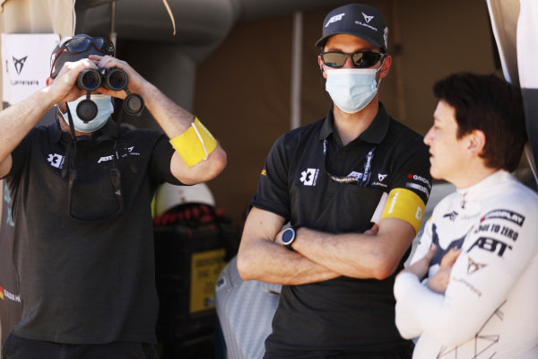 Claudia Hurtgen (GER), ABT CUPRA XE, and the team use binoculars to check out the action