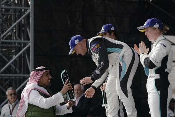 PRO class race winner Simon Evans (NZL), Team Asia New Zealand receives his trophy on the podium
