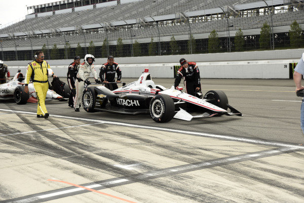 Josef Newgarden, Team Penske Chevrolet's  crew brings the car back to the garage after the rain shortened event
