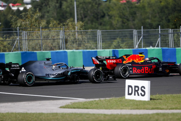 Max Verstappen, Red Bull Racing RB15 and Lewis Hamilton, Mercedes AMG F1 W10 battle