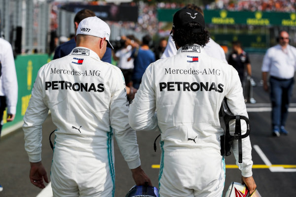 Valtteri Bottas, Mercedes AMG F1, and Lewis Hamilton, Mercedes AMG F1, on the grid after Qualifying