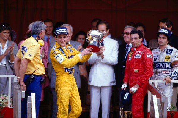 1987 Monaco Grand Prix. Monte Carlo, Monaco. 28th - 31st May 1987.  Ayrton Senna (Lotus 99T Honda),1st position, Michele Alboreto (Ferrari) 3rd position and Nelson Piquet (Williams Honda) 2nd position on the podium. Lotus boss Peter Warr stands next to Senna to collect the constructors prize. Ref-87 MON 12.World Copyright - LAT Photographic