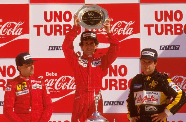 Jacarepagua, Rio de Janeiro, Brazil.5-7 April 1985.Alain Prost (McLaren TAG Porsche) 1st position, Michele Alboreto (Ferrari) 2nd position and Elio de Angelis (Lotus Renault) 3rd position on the podium.Ref-85 BRA 01.World Copyright - LAT Photographic