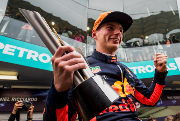 Sepang International Circuit, Sepang, Malaysia. Sunday 1 October 2017. Max Verstappen, Red Bull, 1st Position, celebrates with his team and his trophy. World Copyright: Zak Mauger/LAT Images  ref: Digital Image _56I3722