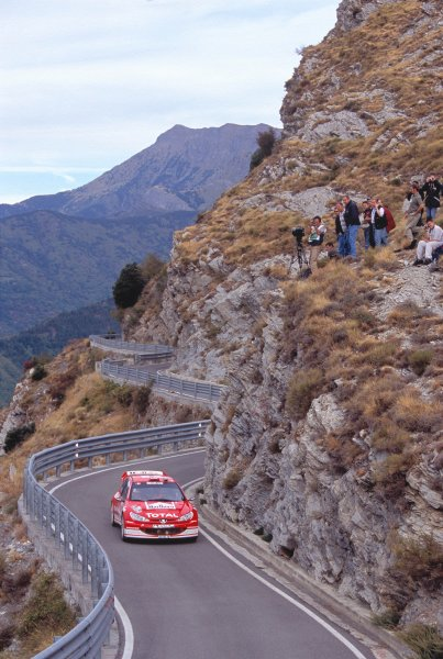2003 World Rally ChampionshipRally of San Remo, Italy. 2nd - 5th October 2003.Harri Rovanpera / Risto Pietilainen, Peugeot 206 WRC. Twisty Mountain Roads, Action.World Copyright: McKLEIN/LATref: 35mm Image WRCSANREMO13 jpg