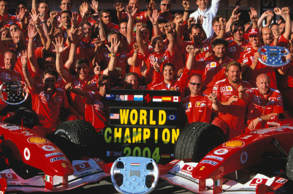 2004 Hungarian Grand Prix Hungaroring, Hungary. 13th - 15th August. The whole Ferrari team celebrate winning the 2004 Constructors title.World Copyright:Michael Cooper/LAT Photographic Ref:35mm Image:A24