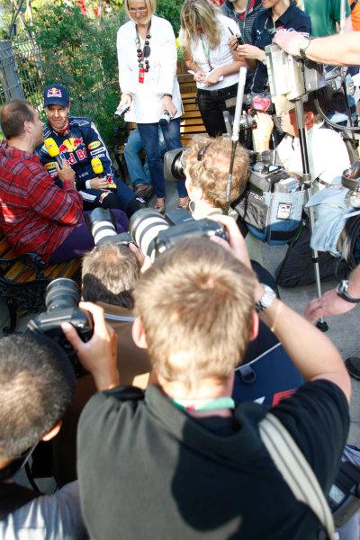 Shanghai International Circuit, Shanghai, China18th April 2009Sebastian Vettel, Red Bull Racing RB5 Renault, is interviewed. Portrait. Media. World Copyright: Charles Coates/LAT Photographicref: Digital Image _26Y4075