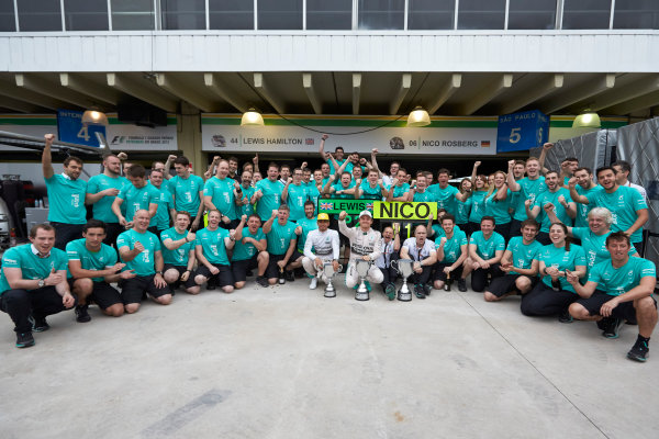 Interlagos, Sao Paulo, Brazil. Sunday 15 November 2015. Lewis Hamilton, Mercedes AMG, 2nd Position, Nico Rosberg, Mercedes AMG, 1st Position, and the Mercedes team celebrate victory. World Copyright: Steve Etherington/LAT Photographic ref: Digital Image SNE13147