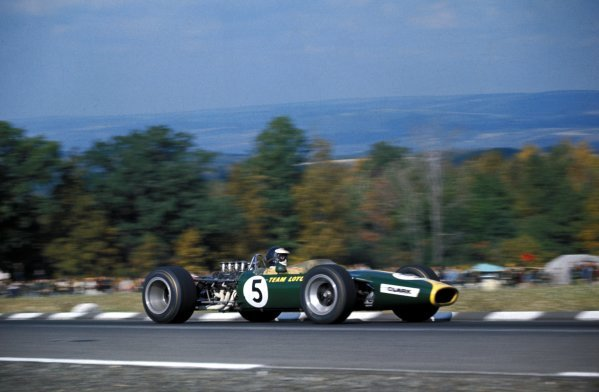 Race winner Jim Clark (GBR) Lotus Ford 49.