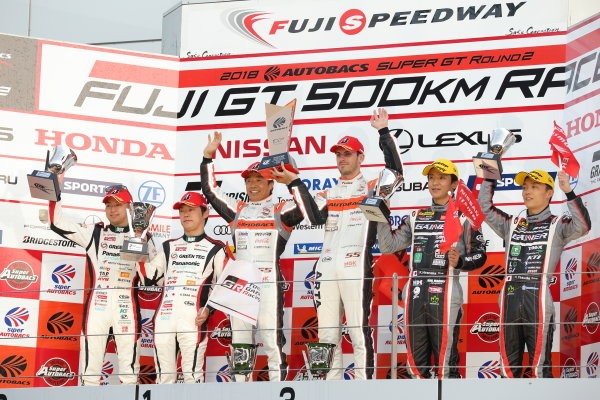 The GT300 winning drivers of the Arta (Autobas Racing Team Aguri) BMW M6 GT3, Shinichi Takagi & Sean Walkinshaw, celebrate on the podium. The second placed Koki Saga & Kohei Hirate, Toyota Prius apr GT, also celebrate, along with Katsuyuki Hiranaka & Hironobu Yasuda of the third position Gainer Tanax Nissan GT-R.