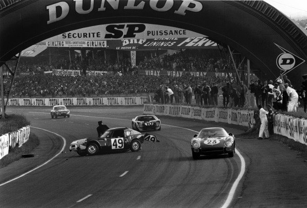 Le Mans, France. 20th - 21st June 1964 Pierre Dumay/Gerard Langlois (Ferrari 250 LM), 16th position, passes the wreckage of Mike Rothschild/Bob Tullius (Triumph Spitfire), retired, on lap 23, action. World Copyright: LAT Photographic Ref:  L64 - 179 - 5A.