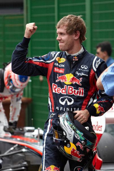 Interlagos, Sao Paulo, Brazil. 26th November 2011. Sebastian Vettel, Red Bull Racing RB7 Renault, celebrates pole in Parc Ferme. Portrait. Helmets.  World Copyright: Steve Etherington/LAT Photographic ref: Digital Image SNE27483