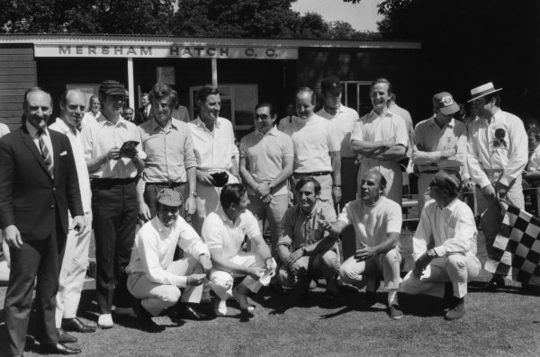 Brands Hatch, Great Britain. 21 July 1968. The team for the traditional post-GP cricket match, back row, left-to-right: Les Leston, Richard Attwood, Piers Courage, Jochen Rindt, Graham Hill, Pedro Rodriguez, Denny Hulme, Charles Lucas, Robin Widdows, Peter Proctor and Peter Jopp. Front row: Innes Ireland, Bruce McLaren, Chris Amon, Stirling Moss and Colin Chapman, The Grand Prix Drivers XI lost to Lord Bradbourne's XI, which included HRH Prince Charles, portrait, atmosphere. World Copyright: LAT Photographic Ref: b&w print