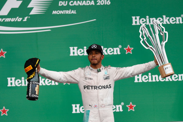 Circuit Gilles Villeneuve, Montreal, Canada. Sunday 12 June 2016. Lewis Hamilton, Mercedes AMG, 1st Position, with his trophy and Champagne. World Copyright: Glenn Dunbar/LAT Photographic ref: Digital Image _V2I5898