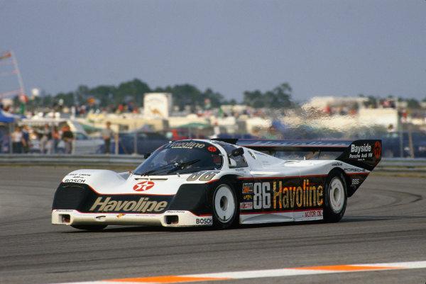 Daytona 24 Hours, Florida, USA. 30th - 31st January 1988. Rd 1.  Klaus Ludwig/Hans-Joachim Stuck/Sarel van der Merwe (Porsche 962), 4th position, action. World Copyright: Bill Murenbeeld/LAT Photographic. Ref: 88IMSA DAY04.