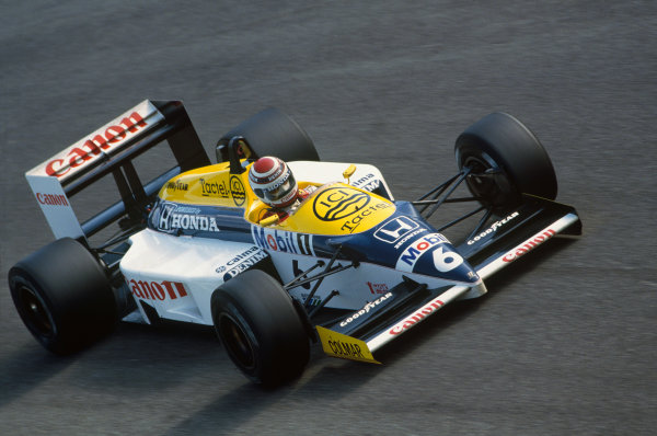 Monza, Italy. 5-7 September 1986. Nelson Piquet (Williams FW11 Honda) 1st position, at Parabolica. Action. Ref: 86 ITA 12. World Copyright - LAT Photographic