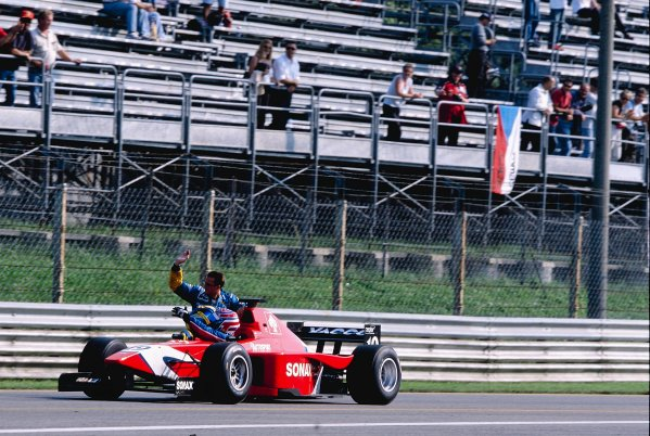 2002 International F3000Monza, Italy. 14th September 2002 3rd position secured the championship title for Tomas Enge (Arden), and he gives a lift back to the pits to his closest rival Sebastien Bourdais (Super Nova).World Copyright: Charles Coates/LAT Photographic ref: 35mm Image A01