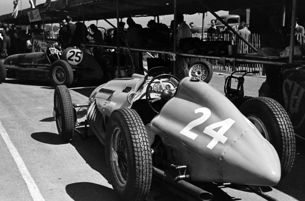 Philippe Étancelin's Talbot-Lago T26C lined up behind Roy Salvadori's Maserati 4CL in the pits.