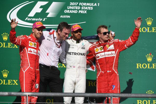 (L to R): Sebastian Vettel (GER) Ferrari, James Allison (GBR) Mercedes AMG F1 Technical Director, Lewis Hamilton (GBR) Mercedes AMG F1 and Kimi Raikkonen (FIN) Ferrari celebrate on the podium at Formula One World Championship, Rd17, United States Grand Prix, Race, Circuit of the Americas, Austin, Texas, USA, Sunday 22 October 2017.