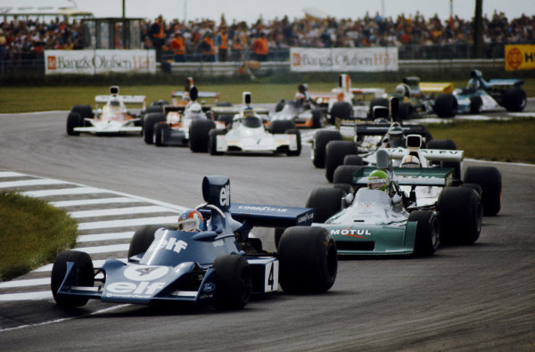 Patrick Depailler, Tyrrell 007 Ford, leads Henri Pescarolo, BRM P160E, and Mike Hailwood, McLaren M23 Ford.