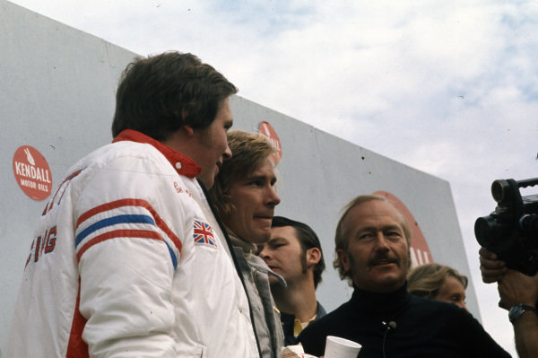 Hesketh boss Lord Alexander Hesketh with James Hunt, 2nd position, and Lotus boss Colin Chapman.