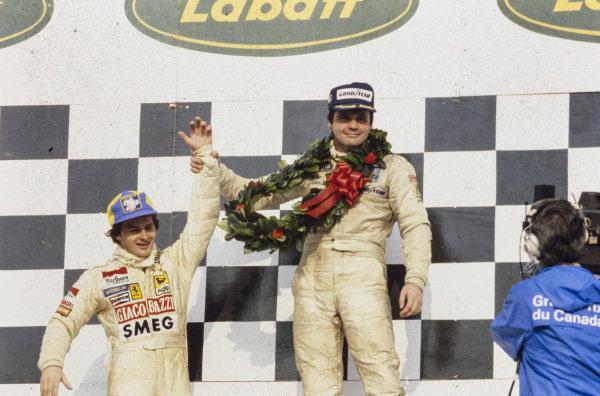 Winner Alan Jones celebrates with home hero Gilles Villeneuve, 2nd position, on the podium.