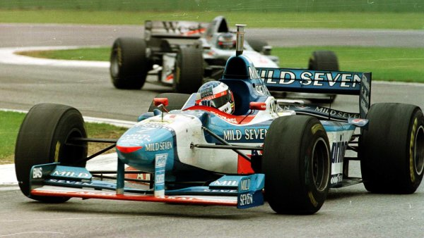 1997 San Marino Grand Prix.Imola, Italy.25-27 April 1997.Jean Alesi (Benetton B197 Renault) leads Mika Hakkinen (McLaren MP4/12 Mercedes-Benz). They finished in 5th and 6th positions respectively.World Copyright - LAT Photographic
