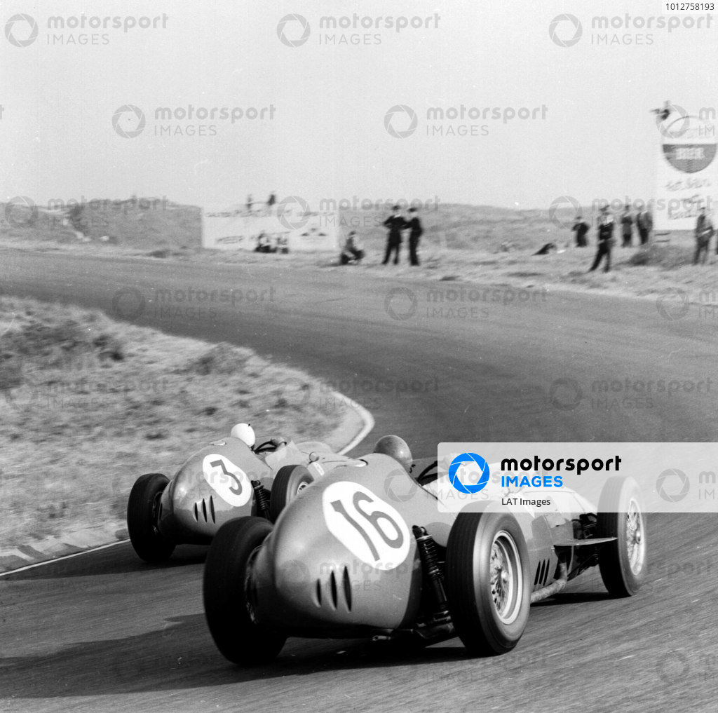 1959 Dutch Grand Prix.Zandvoort, Holland.29-31 May 1959.Phil Hill leads Cliff Allison (both Ferrari Dino 246's). Hill finished in 6th position.Ref-4116B/W.A Race Through Time exhibition number 50.World - LAT Photographic