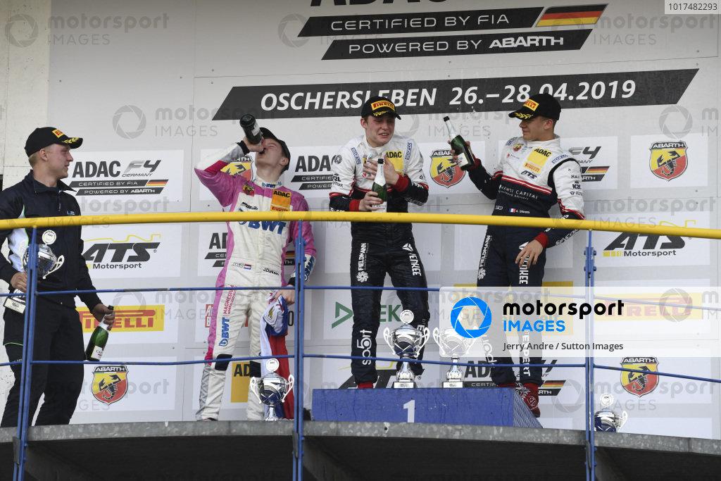 Rookie Winner Roman Stanek, US Racing - CHRS, Second Place, Joshua Dürksen, ADAC Berlin-Brandenburg e.V and Alessandro Ghiretti, US Racing - CHRS on the podium with the champagne
