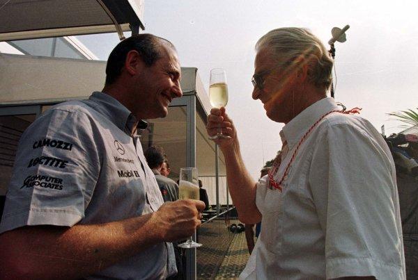 1997 Italian Grand Prix.Monza, Italy.5-7 September 1997.Ron Dennis (McLaren Mercedes-Benz) and Dr Jurgen Hubbert (Daimler-Benz) celebrate victory.World Copyright - Leicester/LAT Photographic
