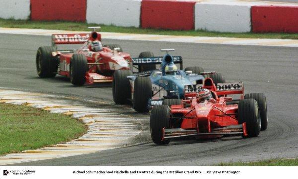 1998 Brazilian Grand Prix.Interlagos, Sao Paulo, Brazil.27-29 March 1998.Michael Schumacher (Ferrari F300) leads Giancarlo Fisichella (Benetton B198 Playlife) and Heinz-Harald Frentzen (Williams FW20 Mecachrome).World Copyright - Steve Etherington/LAT Photographic