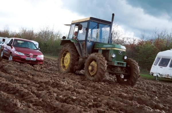 The rain turned the car parks into a quagmire. Many spectators were stuck and had to be towed out of the mud by a tractor.
