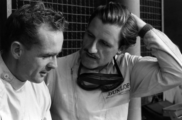 Phil Hill talks to Graham Hill.