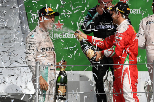Nico Rosberg (GER) Mercedes AMG F1 and Sebastian Vettel (GER) Ferrari celebrate on the podium with the champagne at Formula One World Championship, Rd19, Mexican Grand Prix, Race, Circuit Hermanos Rodriguez, Mexico City, Mexico, Sunday 30 October 2016.