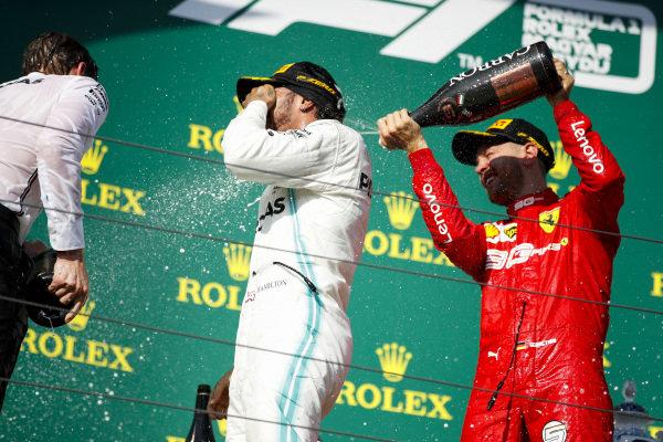 Sebastian Vettel, Ferrari, 3rd position, sprays Champagne over Lewis Hamilton, Mercedes AMG F1, 1st position