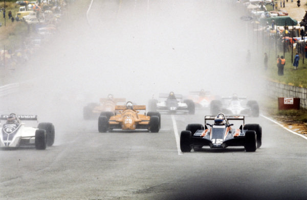 Ricardo Zunino, Brabham BT49B Ford, battles with Nigel Mansell, Lotus 81 Ford, at the start. They lead Riccardo Patrese, Arrows A3 Ford, Siegfried Stohr, Arrows A3 Ford, Alan Jones, Williams FW07B Ford, and Derek Daly, March 811 Ford.