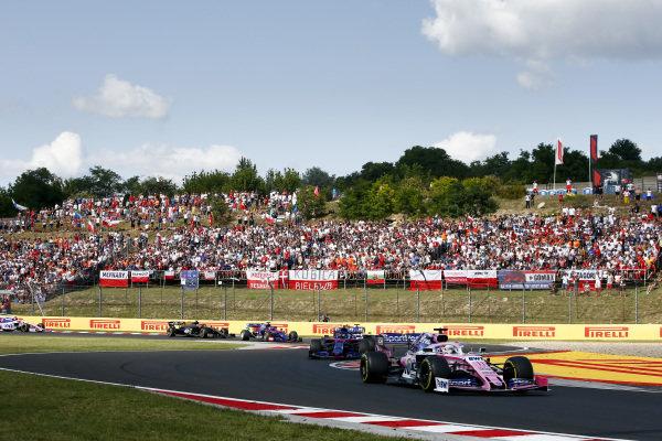 Sergio Perez, Racing Point RP19, leads Alexander Albon, Toro Rosso STR14, and Daniil Kvyat, Toro Rosso STR14