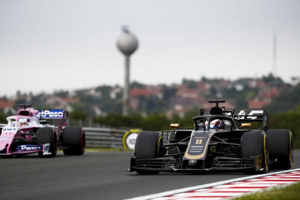Romain Grosjean, Haas VF-19, leads Sergio Perez, Racing Point RP19