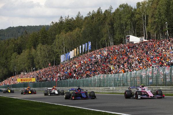 Lance Stroll, Racing Point RP19, leads Daniil Kvyat, Toro Rosso STR14 and Antonio Giovinazzi, Alfa Romeo Racing C38
