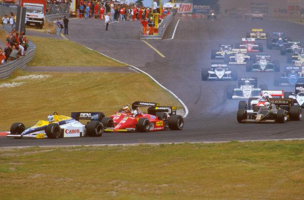 Nurburgring, Germany.2-4 August 1985.Keke Rosberg (Williams FW10 Honda) leads Stefan Johansson and Michele Alboreto (both Ferrari 156/85's) at the start. Senna has already gone through the shot.Ref-85 GER 04.World Copyright - LAT Photographic