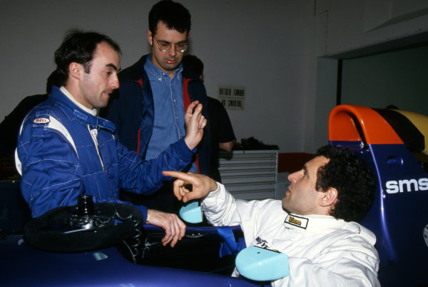 David Brabham (AUS) (Left) talks with team mate Roland Ratzenberger (AUT) (Right) in the Simtek S941 and Nick Wirth (GBR) Simtek Team Principal (Centre). Formula One Testing, Imola, Italy, 7-11 March 1994.