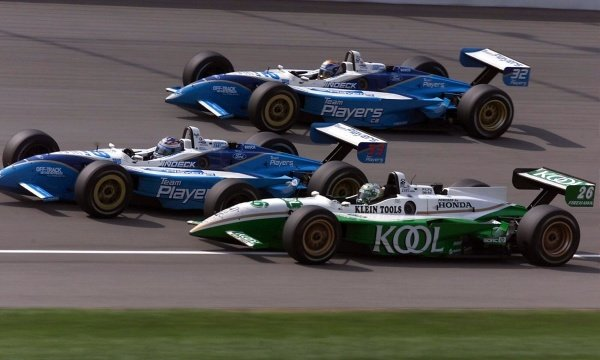 All Canadian formation of (Bottom to top) Paul Tracy (CDN) Team Green, Alex Tagliani (CDN) Players Forsythe and first time race winner Patrick Carpentier (CDN)Players Forsythe.Michigan 500, Brooklyn, Milwaukee, USA, 22 July 2001.