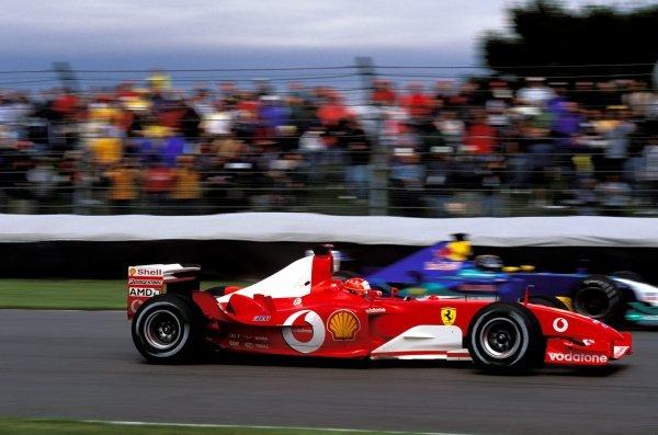 Michael Schumacher (GER), Ferrari F2003-GA, won the US Grand Prix.United States Grand Prix, Rd15, Indianapolis Motor Speedway, Indianapolis, USA. 28 September 2003.BEST IMAGE