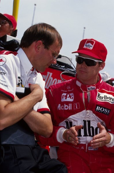 Al Unser Jr (USA) Penske Racing talks with his engineer.