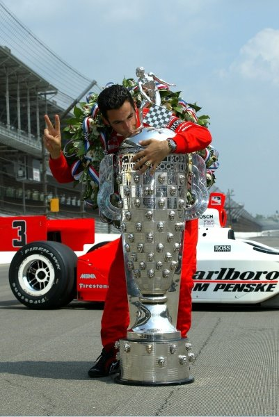 Helio Castroneves kisses the Borg Warner trophy for the second year in a row, winning the Indianapolis 500, Indianapolis Motor Speedway, Indianapolis, IN, 27, May, 2002. IR05A