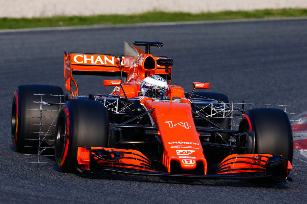 Circuit de Barcelona Catalunya, Barcelona, Spain. Monday 27 February 2017. Fernando Alonso, McLaren MCL32 Honda, carries sensor equipment.  World Copyright: Zak Mauger/LAT Images ref: Digital Image _L0U9852
