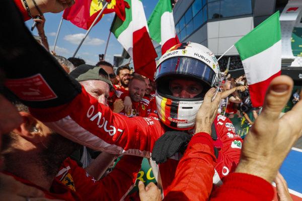 Sebastian Vettel, Ferrari, 1st position, celebrates with his team on arrival in Parc Ferme.