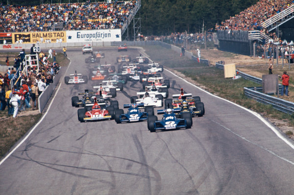 1974 Swedish Grand Prix  Anderstorp, Sweden. 7-9 June 1974.  Jody Scheckter, Tyrrell 007 Ford, 1st position, leads at the start from Ronnie Peterson, Lotus 72E Ford, retired, Patrick Depailler, Tyrrell 007 Ford, 2nd position, and Niki Lauda, Ferrari 312B3, retired.  Ref: 74SWE05. World Copyright: LAT Photographic